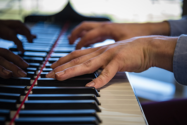 Medical student Jesse Wayson has a talent for piano.