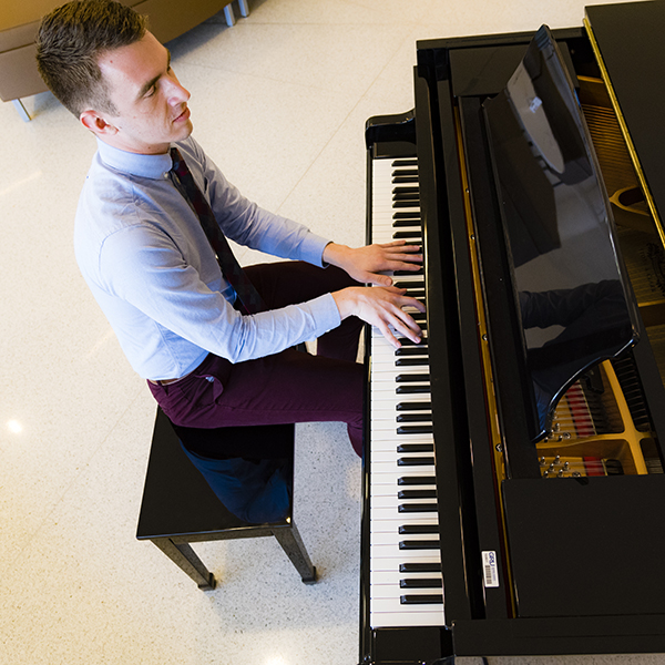 Piano is a stress reliever for medical student Jesse Wayson