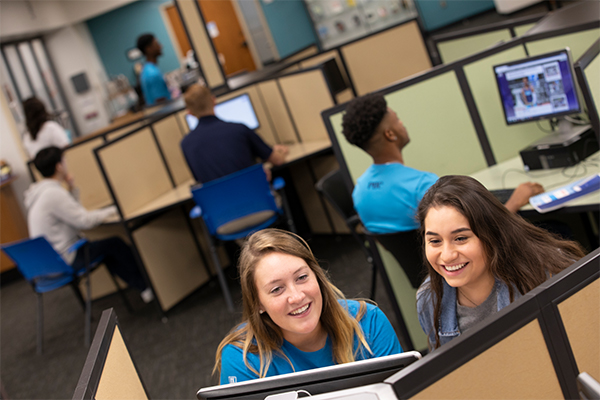 Female students working at computer