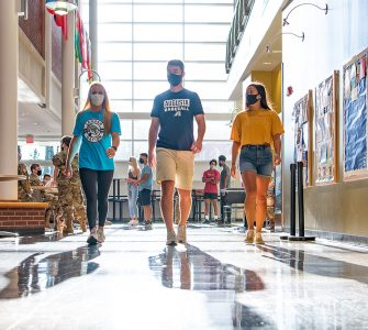 Students walking in campus building